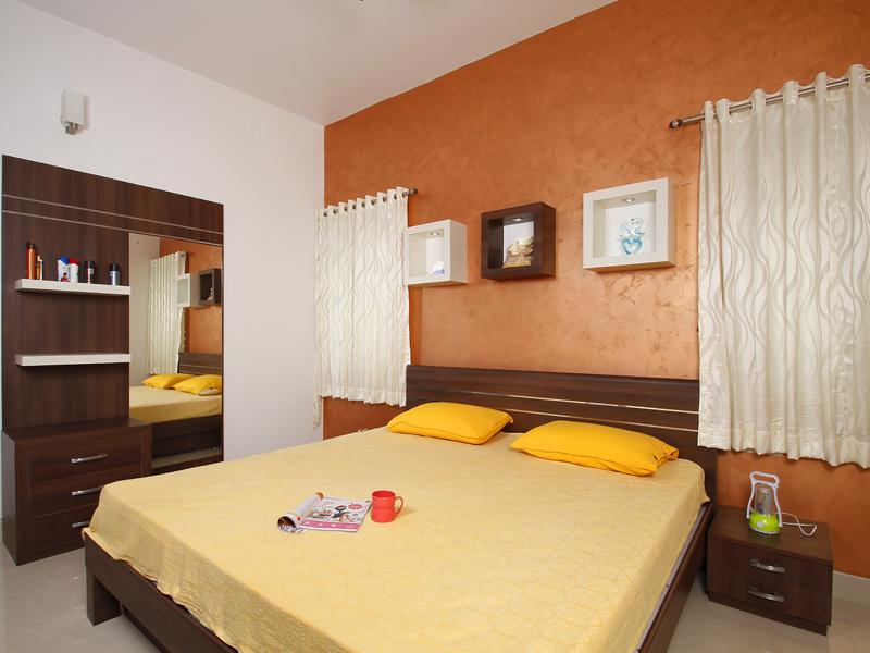 kerala house plans with estimate for a 2900 sq ft home designthese days bedroom is based on certain theme colors which makes it look very beautiful dark orange colour is used to highlight the wall behind the bed